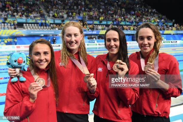 Wales' Georgia Davies Chloe Tutton Alys Thomas and Kathryn Greenslade pose with their medals after the swimming women's 4x100m medley relay final...