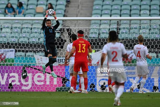 Wales' goalkeeper Danny Ward makes the save during the UEFA EURO 2020 Group A football match between Wales and Switzerland at the Olympic Stadium in...