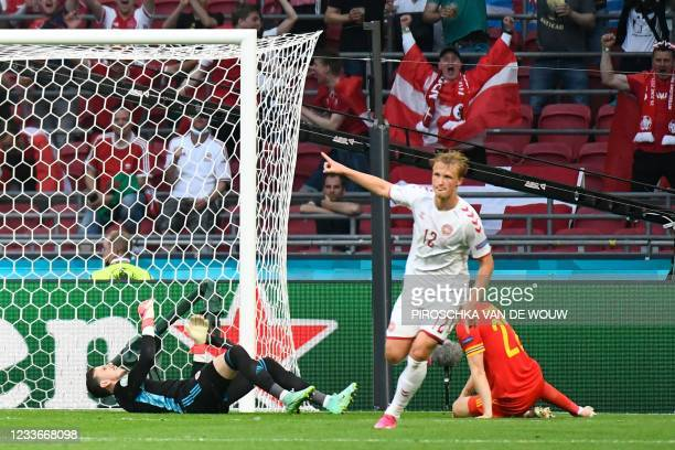 Wales' goalkeeper Danny Ward reacts after conceding a second goal to Denmark's forward Kasper Dolberg during the UEFA EURO 2020 round of 16 football...