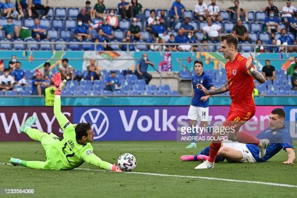 Wales' goalkeeper Danny Ward saves a shot during the UEFA EURO 2020 Group A football match between Italy and Wales at the Olympic Stadium in Rome on...