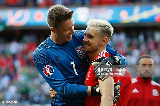 Wales' goalkeeper Wayne Hennessey and Wales' midfielder Aaron Ramsey celebrate after their victory during the Euro 2016 round of sixteen football...