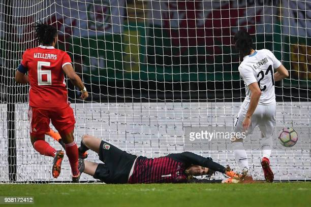 TOPSHOT Wales' goalkeeper Wayne Hennessey fails to save the ball for a goal by Uruguay's Edinson Cavani during their China Cup International Football...