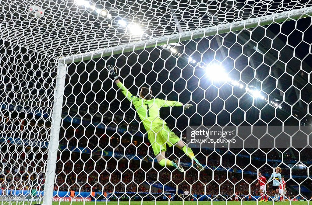 TOPSHOT - Wales' goalkeeper Wayne Hennessey jumps for the ball during the Euro 2016 quarter-final football match between Wales and Belgium at the Pierre-Mauroy stadium in Villeneuve-d'Ascq near Lille, on July 1, 2016. Wales won the match 3-1. / AFP / Emmanuel DUNAND