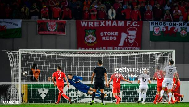 Wales' goalkeeper Wayne Hennessey stops the ball during the FIFA World Cup 2018 qualification football match between Georgia and Wales in Tbilisi on...