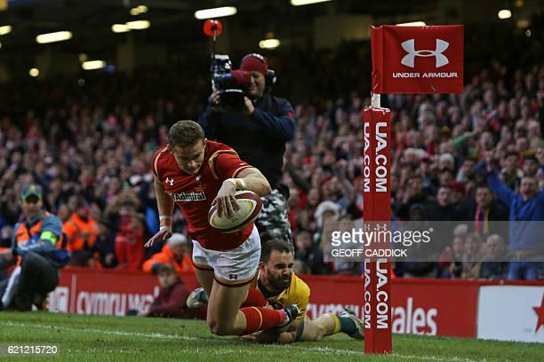 Wales' Hallam Amos is taken into touch by Australia's Nick Frisby preventing a try during the Autumn international rugby union Test between Wales and...