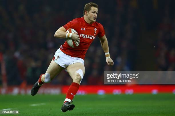 Wales' Hallam Amos runs with the ball before passing to Wales' centre Scott Williams who went on to score their first try during the international...