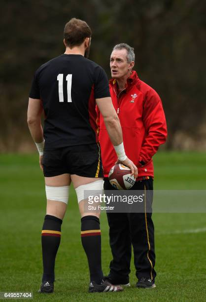 Wales head coach Robert Howley chats with captain Alun Wyn Jones during training in the lead up to the RBS Six Nations match against Ireland at the...