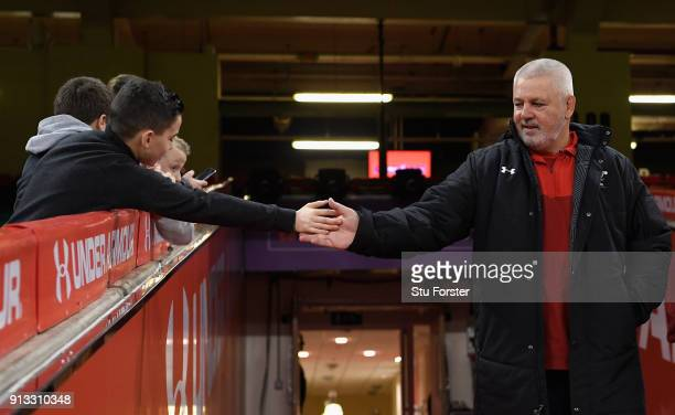 Wales head coach Warren Gatland high fives a young fan before the captain's run ahead of their opening Six Nations match against Scotland at...