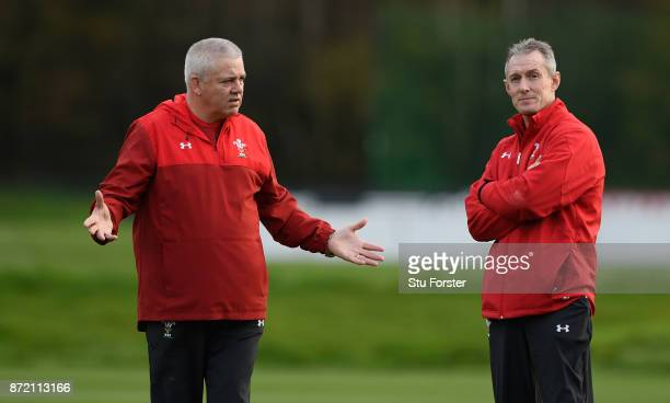 Wales Head coach Warren Gatland reacts whilst talking to assistant Robert Howley during Wales Media access ahead of their game against the Australian...