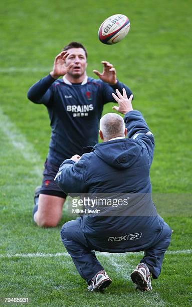 Wales head coach, Warren Gatland speaks runs through drills with lock forward, Ian Gough during the Wales rugby union training session at Twickenham...