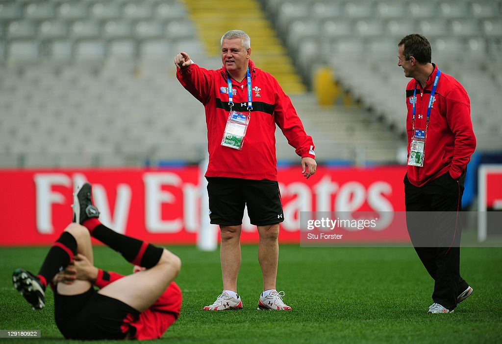 Wales head coach Warren Gatland (C) speaks with his assistant coach Rob Howley (R) during a Wales IRB Rugby World Cup 2011 captain's run at Eden Park on October 14, 2011 in Auckland, New Zealand.