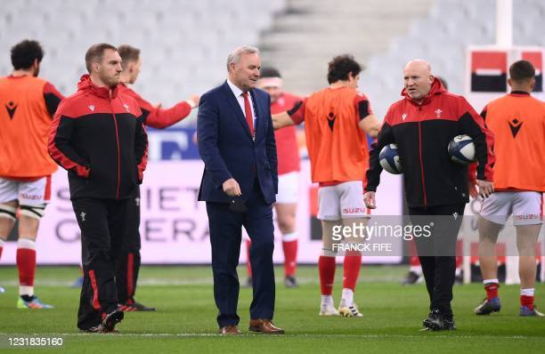 Wales' head coach Wayne Pivac speaks with Wales' skills coach Neil Jenkins and Wales' defence coach Gethin Jenkins prior to the Six Nations rugby...