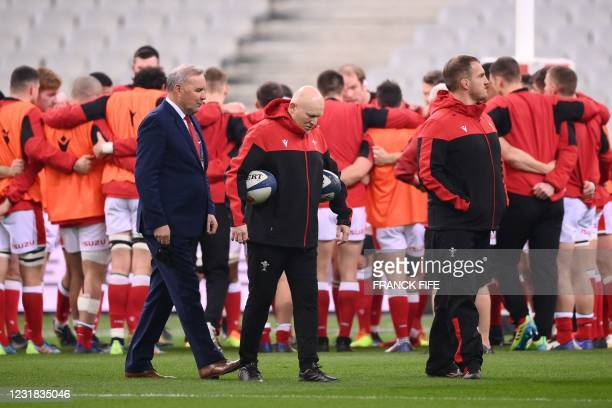 Wales' head coach Wayne Pivac walks with Wales' skills coach Neil Jenkins and Wales' defence coach Gethin Jenkins prior to the Six Nations rugby...