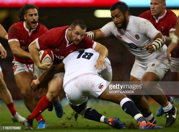 Wales' hooker Ken Owens is tackled by England's prop Kyle Sinckler during the international Test rugby union match between Wales and England at...
