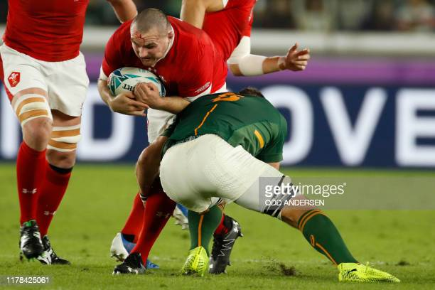 Wales' hooker Ken Owens is tackled by South Africa's number 8 Duane Vermeulen during the Japan 2019 Rugby World Cup semifinal match between Wales and...