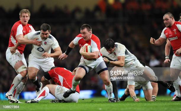Wales' hooker Matthew Rees is tackled by England's flanker Tom Wood during the Six Nations International rugby union match between Wales and England...
