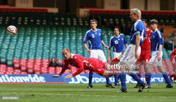 Wales' James Collins has a headed attempt on goal