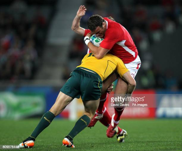 Wales' Jamie Roberts is tackled by Australia's Adam AshleyCooper