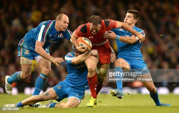 Wales' Jamie Roberts is tackled by Italy's Sergio Parisse Michele Campagnaro and Tommaso Allan during the RBS 6 Nations match at the Millennium...