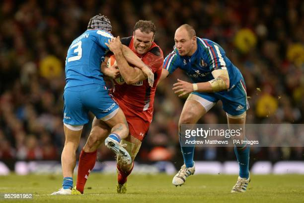 Wales' Jamie Roberts runs away from Italy's Sergio Parisse into a tackle from Italy's Michele Campagnaro during the RBS 6 Nations match at the...