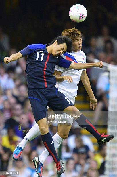 CARDIFF Wales Japan's Kensuke Nagai attempts to head the ball during the first half of the men's soccer bronze medal match against South Korea at...