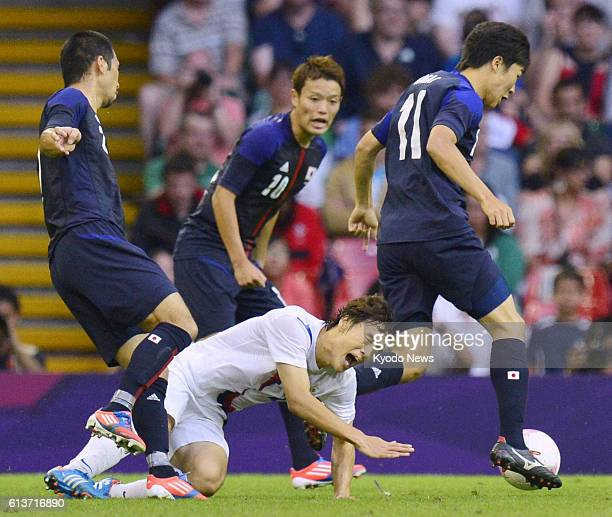 CARDIFF Wales Japan's Kensuke Nagai dribbles with the ball during the first half of the men's soccer bronze medal match against South Korea at...