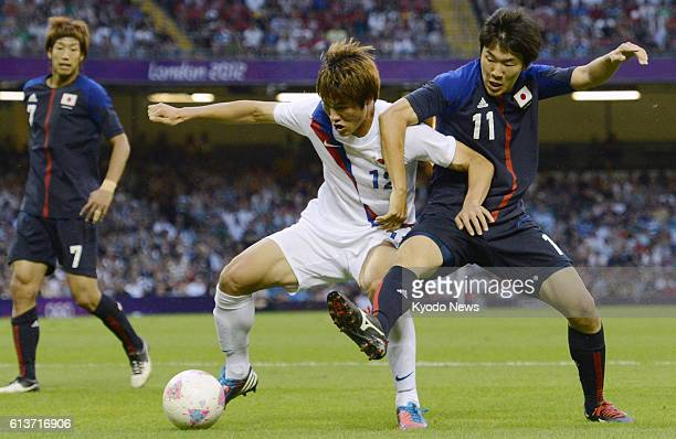 CARDIFF Wales Japan's Kensuke Nagai vies for the ball during the first half of the men's soccer bronze medal match against South Korea at Millennium...