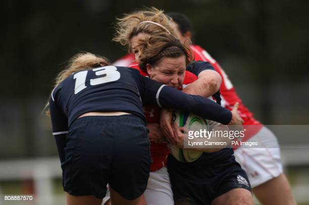 Wales' Jenny Davies is tackled