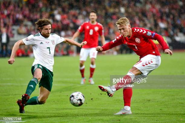 Wales' Joe Allen and Denmark's Viktor Fisher vie with the ball during the Nations League football match between Denmark and Wales on September 9 2018...