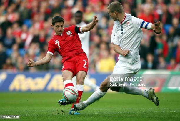 Wales' Joe Allen is tackled by Norway's Brede Hangeland during the International Friendly at Cardiff City Stadium Cardiff