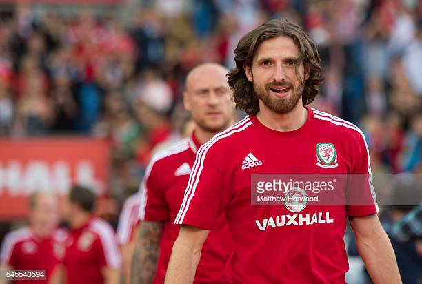 Wales' Joe Allen walks onto the pitch during a ceremony at the Cardiff City Stadium on July 8 2016 in Cardiff Wales The players toured the streets of...