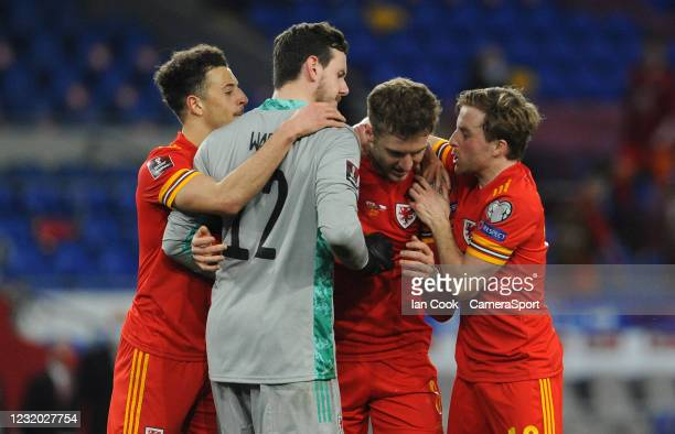 Wales Joe Rodon is swamped by his teams at the final whistle during the FIFA World Cup 2022 Qatar qualifying match between Wales and Czech Republic...