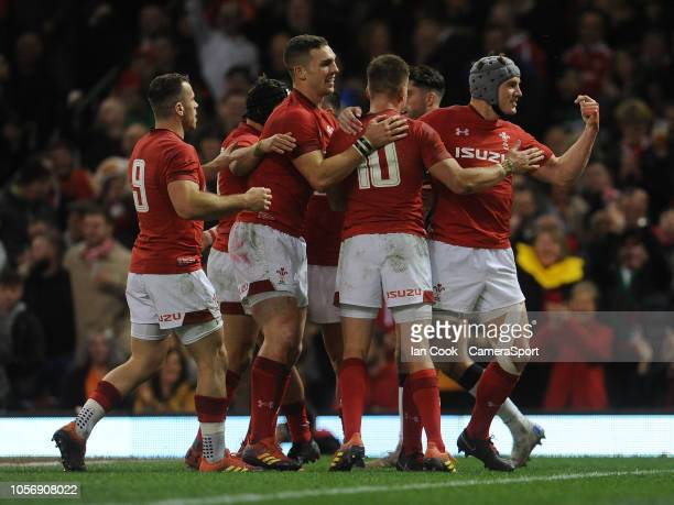 Wales' Jonathan Davies celebrates scoring his side's second try with teammates during the International Friendly match between Wales and Scotland on...