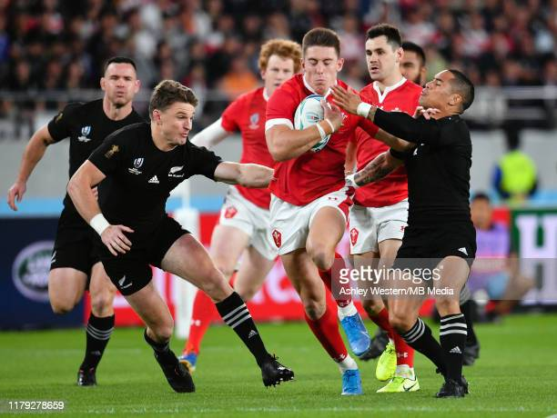 Wales' Josh Adams evades the tackle of New Zealand's Beauden Barrett and Aaron Smith during the Rugby World Cup 2019 Bronze Final match between New...