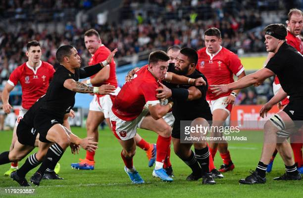 Wales' Josh Adams is tackled by New Zealand's Nepo Laulala during the Rugby World Cup 2019 Bronze Final match between New Zealand and Wales at Tokyo...