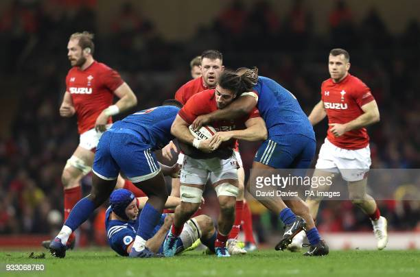 Wales' Josh Navidi is tackled by France's Cedate Gomes Sa and Jefferson Poirot during the NatWest 6 Nations match at the Principality Stadium Cardiff