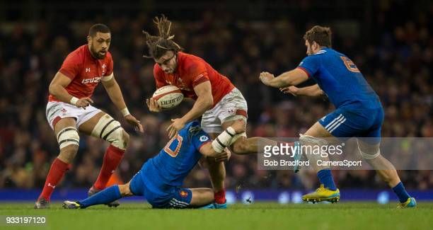 Wales' Josh Navidi is tackled by France's Francois TrinhDuc during the NatWest Six Nations Championship match between Wales and France at...