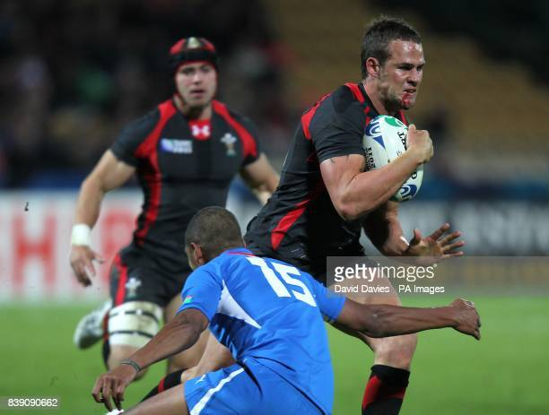 Wales' Lee Byrne is tackled by Namibia's Chrysander Botha