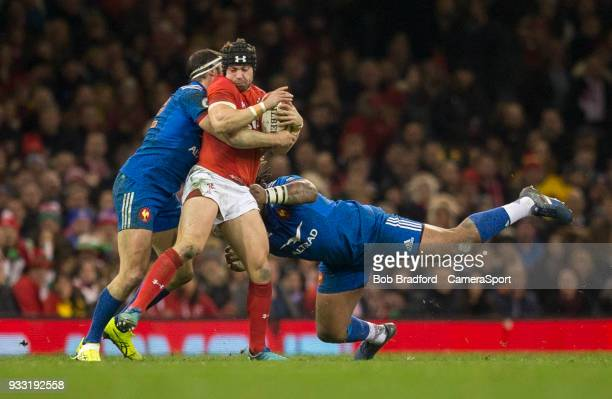 Wales' Leigh Halfpenny is tackled by France's Mathieu Bastareaud and Geoffrey Doumayrou during the NatWest Six Nations Championship match between...