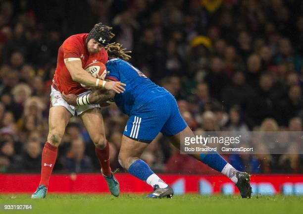 Wales' Leigh Halfpenny is tackled by France's Mathieu Bastareaud during the NatWest Six Nations Championship match between Wales and France at...