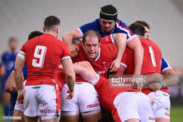 Wales' lock Alun Wyn Jones and France's number 8 Gregory Alldritt vie in a ruck during the Six Nations rugby union tournament match between France...