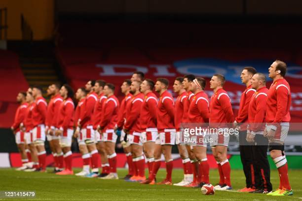 Wales' lock Alun Wyn Jones and players sing the anthem ahead of the Six Nations international rugby union match between Wales and England at the...