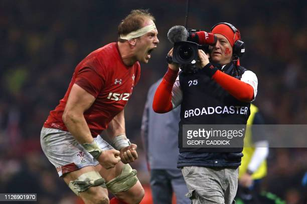 Wales' lock Alun Wyn Jones celebrates their win on the pitch after the Six Nations international rugby union match between Wales and England at the...
