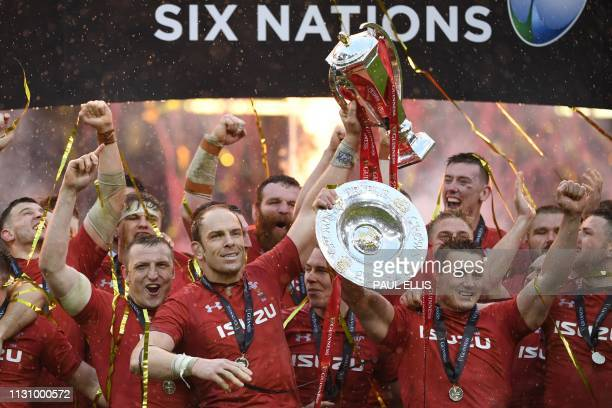 Wales' lock Alun Wyn Jones holds up the trophy after being crowned Six Nations rugby champions after beating Ireland at the Principality Stadium in...