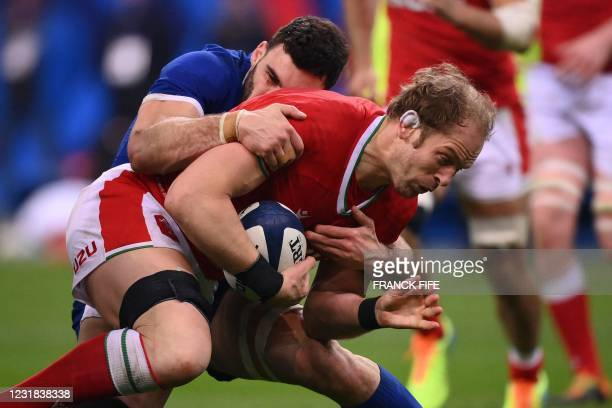 Wales' lock Alun Wyn Jones is tackled by France's flanker Charles Ollivon during the Six Nations rugby union tournament match between France and...