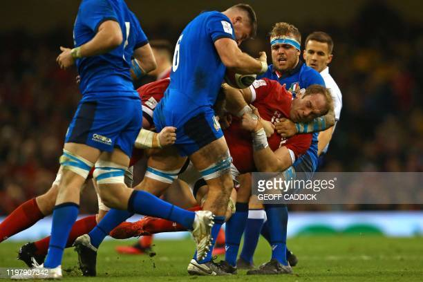 TOPSHOT Wales' lock Alun Wyn Jones is tackled by Italy's lock Niccolo Cannone during the Six Nations international rugby union match between Wales...