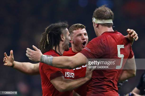 Wales' lock Alun Wyn Jones Wales' flanker Josh Navidi and Wales' hooker Elliot Dee celebrate their win on the pitch after the Six Nations...