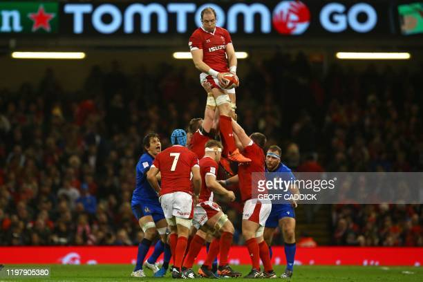 TOPSHOT Wales' lock Alun Wyn Jones wins lineout ball during the Six Nations international rugby union match between Wales and Italy at the...
