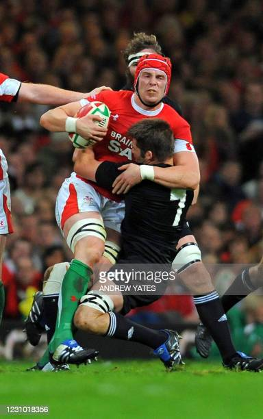 Wales lock Alun-Wyn Jones is tackled by New Zealand flanker Richie McCaw during the International rugby union match between Wales and New Zealand at...