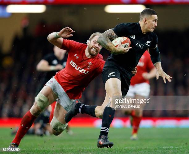 Wales' lock and captain Alun Wyn Jones chases New Zealand's centre Sonny Bill Williams during the Autumn international rugby union Test match between...